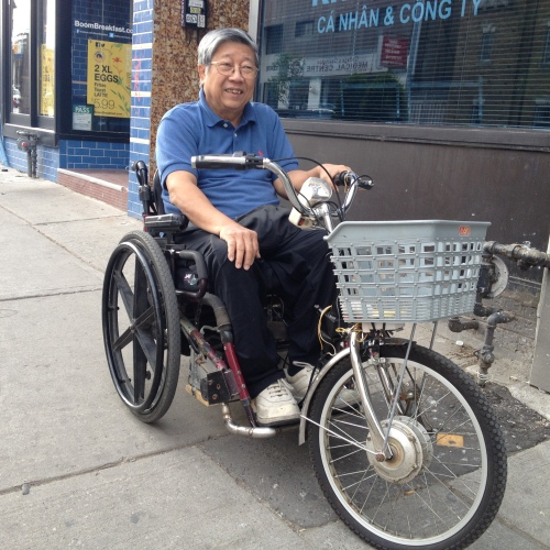 Hung Ho, a retired computer programmer, ingeniously reinvented his wheelchair! Equipped with a basket, welded bicycle tire, handlebars, and a headlight, Hung is cruising the city streets like no other.
